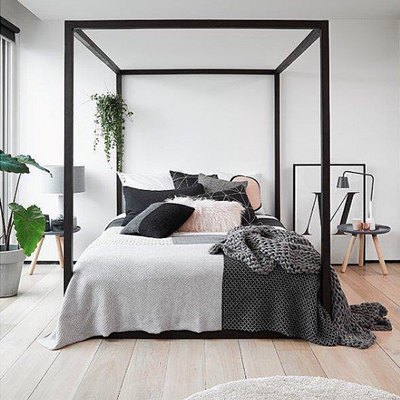 Cozy Textural Throws Complete This Stunning Minimal Bedroom