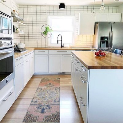 Subway Tile and Industrial Accents Complete a Contemporary Kitchen
