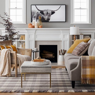 living room with sofa, ottoman, chair, and fireplace