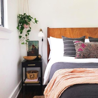 Sophisticated Hues and Organic Accents Elevate a Charming Bedroom