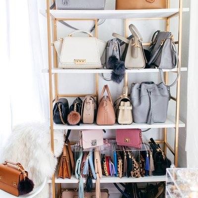 handbag storage on brass bookcase
