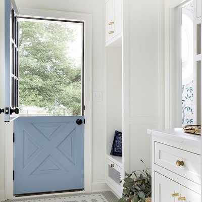 mudroom with the word hello in mosaic tile at door