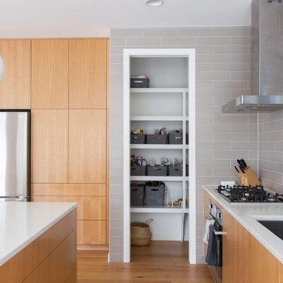 honey oak cabinets and gray backsplash tile