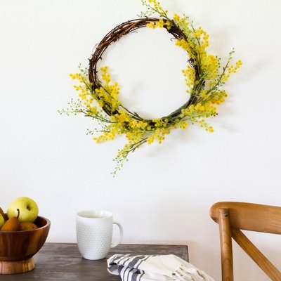 Target decor: Yellow crespedia wreath hanging above table