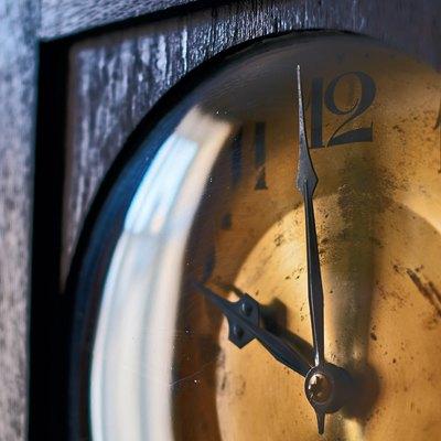 Vintage grandfather clock clockface