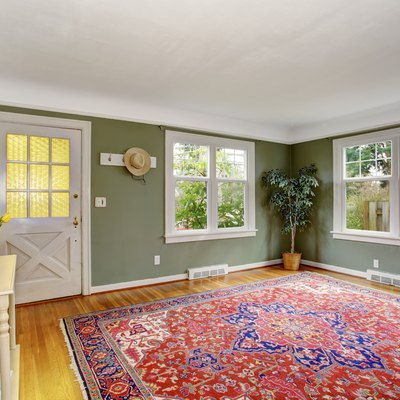 How to Get Rid of Yellow Stains From a Rug on Flooring