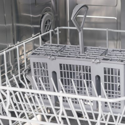 front view of gray grates of a dishwasher without dishes