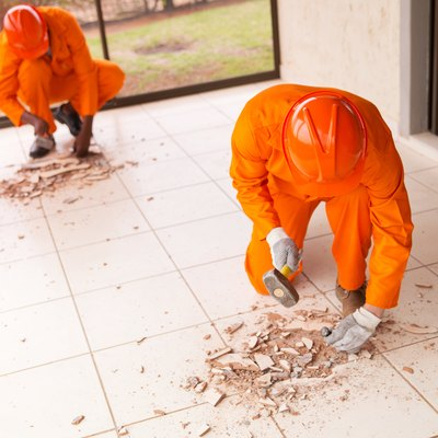 contractors removing old floor tiles