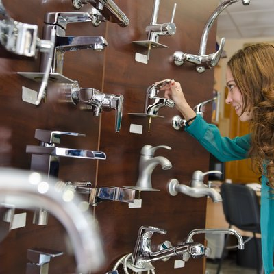 Woman looking faucets at store