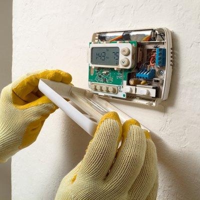 Air conditioning repair man performing maintenance