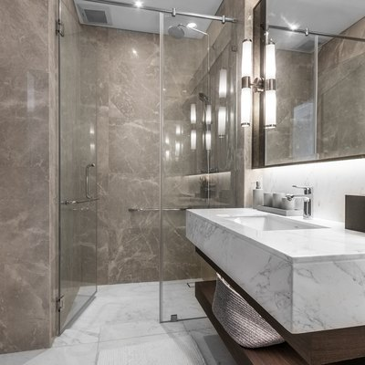 Clean and white bathroom with amenities.