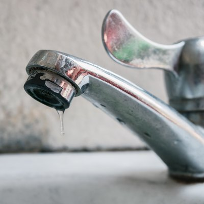 Close-Up Of Water Dripping From Faucet