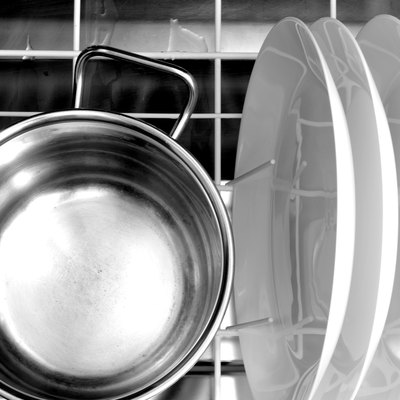clean dishes and a aluminum pot in the dishwasher