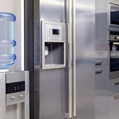 Stainless appliances and water dispenser of a modern kitchen