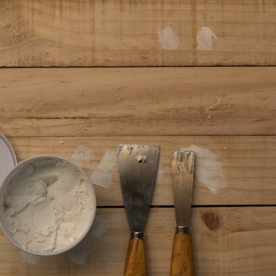 Putty knife and the wooden floor.