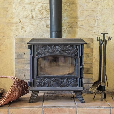 Beautiful wood stove with fireplace tools