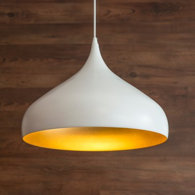 Close-Up Of Pendant Light Hanging Against Wooden Wall
