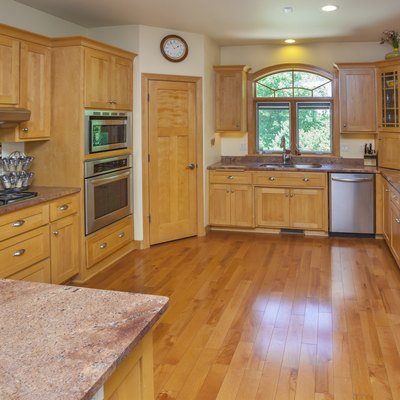Spacious Custom Kitchen With Hardwood Floor, Cabinets, Marble Counters