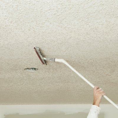 Worker Troweling Drywall Mud on a Ceiling for Knockdown Texture