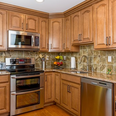 Kitchen with mocha wood cabinetry