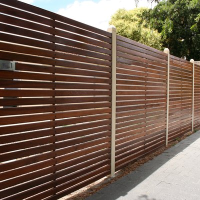 How to Paint or Stain a Wood Fence to Prevent Termites