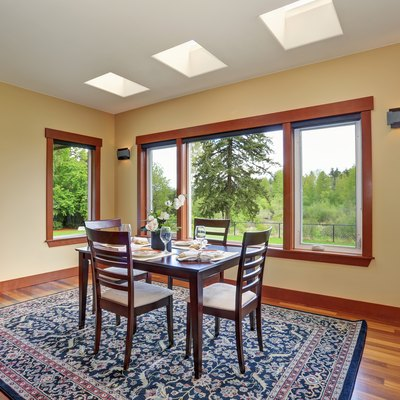 Bright dining room interior design with elegant table setting