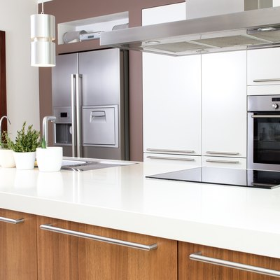 Conception of modern kitchen with household goods.