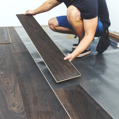 laminate flooring - worker installing new floor