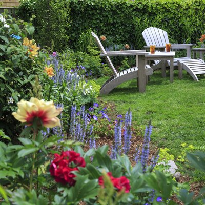 Back yard garden with peonies and two chairs