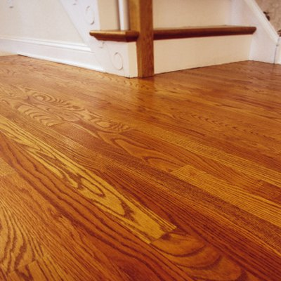 Pros & Cons of Engineered Wood Floors That Float or Glue Down