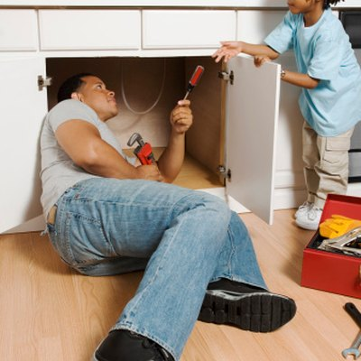 How to Replace the Floor in the Cabinet Under the Kitchen Sink