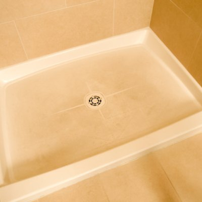 How to Remove Adhesive From a Fiberglass Shower