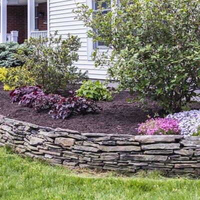 New Mulch Behind Landscaped Garden Terrace Wall