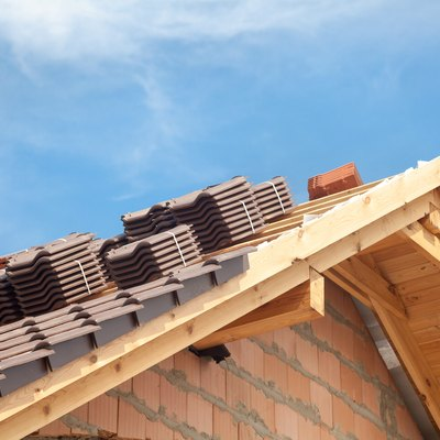 How to Increase the Pitch by Building a Roof Over an Existing Roof