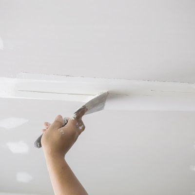 Hands of the ceiling technician