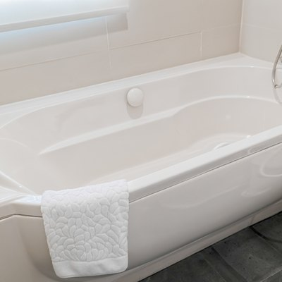 Fragment of a luxury bathroom with a detail of bathtub