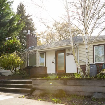 Wide exterior shot of a 1940 style bungalow style house in Portland Oregon.