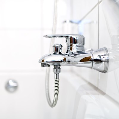 close up of luxury bathroom tap and bathtub