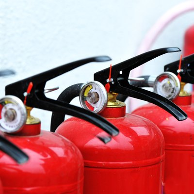 Red fire extinguishers lined up