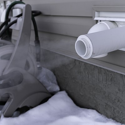Furnace exhaust pipe blowing out steam in winter