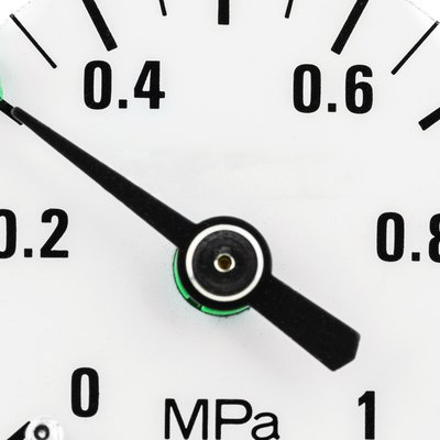 A macro photo of a pressure gauge scale to 1 Mpa showing a pressure of 0.3 Mpa, isolated on a white background.