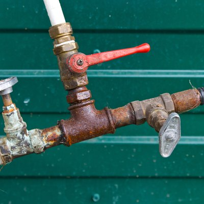 Connection hoses, old rusty plumbing valves
