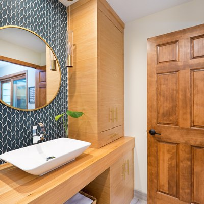 Contemporary Bathroom Design with Above Counter Vessel Sink and Vanity