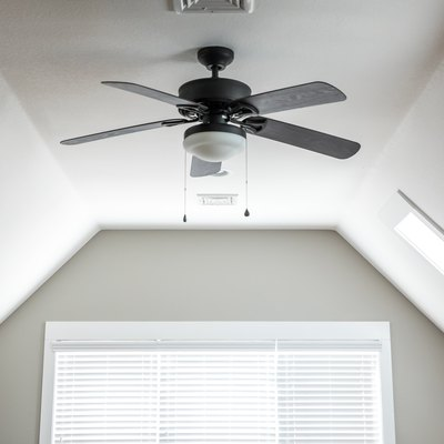 Open and airy bonus room game room in a new construction house with a dark wood ceiling fan, a window and blinds
