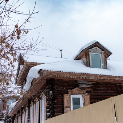 Wooden houses under the snow