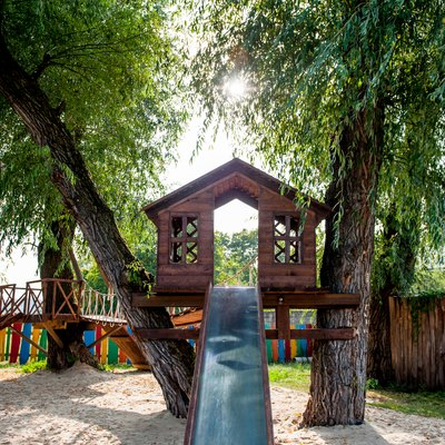 tree house with a slide on the playground