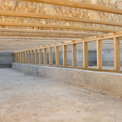 Construction Site: Neat Clean Crawlspace, Floor Joists, and Pony Wall