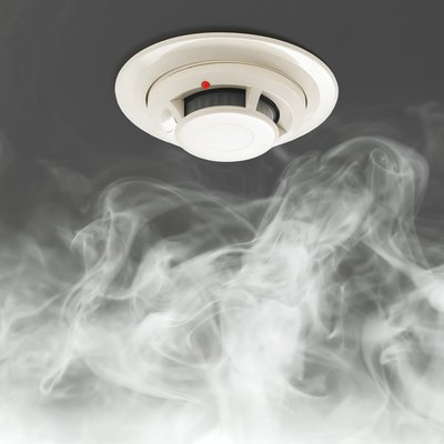 smoke detector on ceiling, fire alarm in action