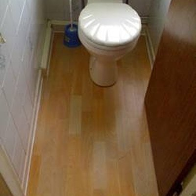 How to Lay Laminate Flooring Around a Toilet
