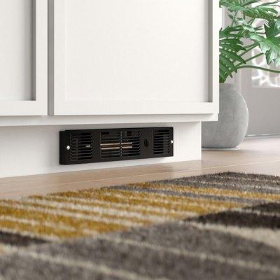 A black electric baseboard on a cabinet's toe kick